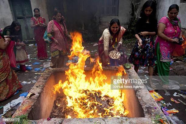 KATHMANDU Sept 6 2016 Nepalese Hindu women offer prayers during Rishi Panchami festival at Risheshwor Mahadev in Kathmandu capital of Nepal Sept 6...