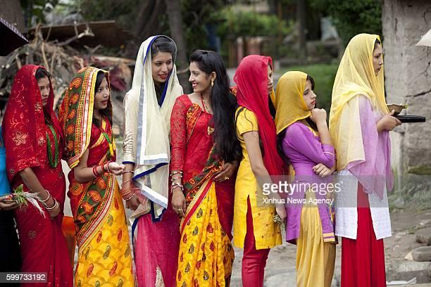 KATHMANDU Sept 6 2016 Nepalese Hindu women stand in queue to offer prayers during Rishi Panchami festival at Risheshwor Mahadev in Kathmandu capital...