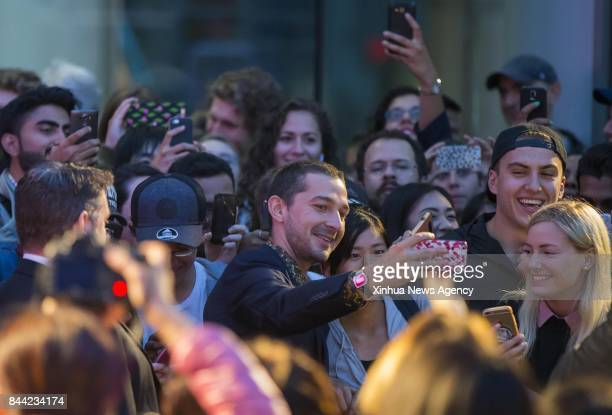 TORONTO Sept 8 2017 Actor Shia LaBeouf poses for photos with fans on the premiere of the film 'Borg/McEnroe' during the 2017 Toronto International...