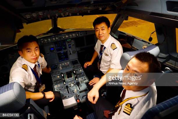 BEIJING Sept 8 2017 Captains Shang Feng Qu Weicheng and observer Chen Guannan pose for a photo after flying an A320 in a test flight under...