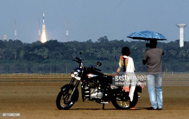 People watch the launch of GSLVFO5 rocket carrying weather satellite INSAT3DR near the space station in Sriharikota Indian state of Andhra Pradesh...