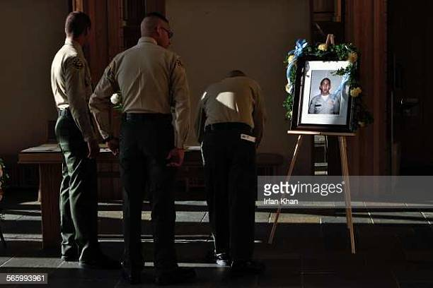 WHITTIER CA September 02 2011 Los Angeles County Sheriff's explorer write on the condolence book at the funeral of a slain Whittier man who...