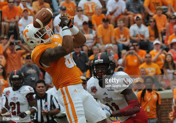 Johnathon Johnson Tennessee Volunteers wide receiver lets a pass slip through his hands as Sterling Young Arkansas State Red Wolves defensive back...
