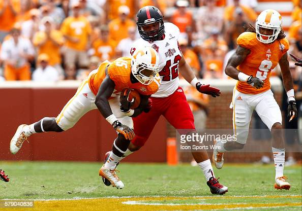 Tennessee Volunteers running back Marlin Lane slips past Arkansas State Red Wolves defensive end Chris Stone at Neyland Stadium in Knoxville Tennessee