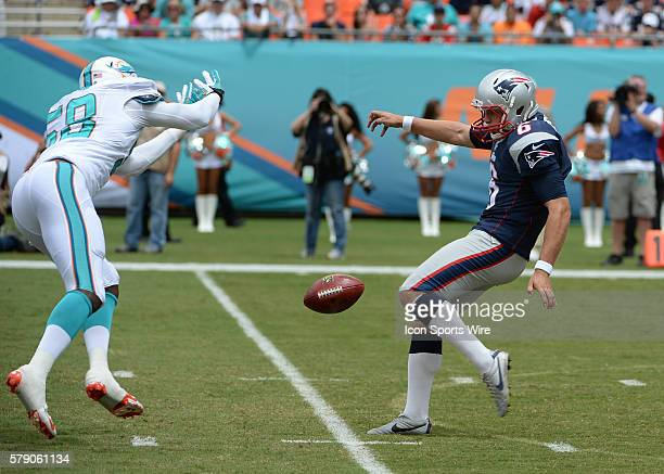 September 07 2014 Miami Dolphins linebacker Chris McCain blocks the punt from New England Patriots punter Ryan Allen during a game between the Miami...