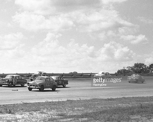 Action during the Southern 500 NASCAR Cup race at Darlington Raceway has Lee Patty in a 1951 Plymouth racing sidebyside with the 1951 Hudson Hornet...