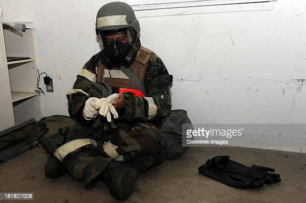 September 1, 2011 - Senior Airman dons his chemical warfare defense ensemble at Little Rock Air Force Base, Arkansas.