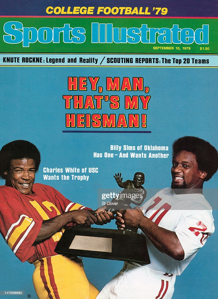 September 10, 1979 Sports Illustrated Cover: College Football: NCAA Season Preview: Portrait of USC Charles White (12) and Oklahoma <a gi-track='captionPersonalityLinkClicked' href=/galleries/search?phrase=Billy+Sims&family=editorial&specificpeople=541482 ng-click='$event.stopPropagation()'>Billy Sims</a> (20) with Heisman Trophy during photo shoot. USA 8/17/1979CREDIT: Steve Schapiro/Sygma
