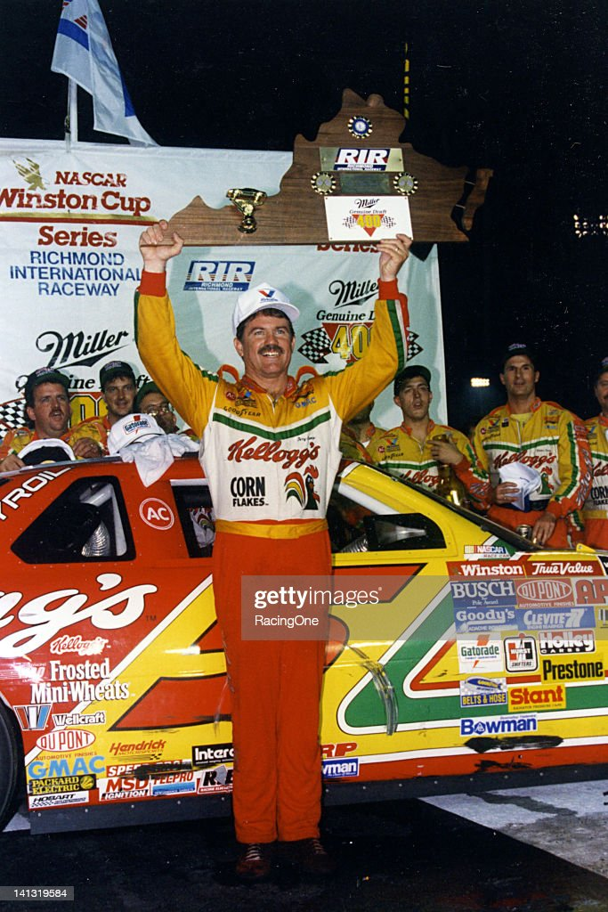 Terry Labonte raises his trophy in the air during victory lane ceremonies following the Miller Genuine Draft 400 NASCAR Cup race at Richmond...