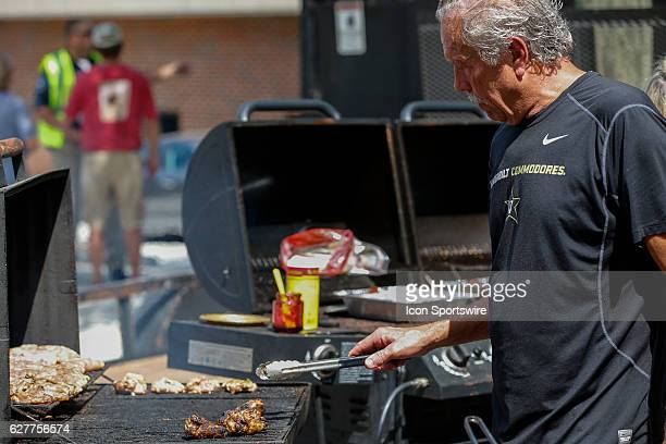 A Vanderbilt fan cooks chicken during pre game in Vandyville as the Commodores defeated Middle Tennessee 4724 at Vanderbilt Stadium in Nashville...