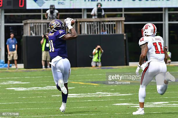 September 10 2016 East Carolina Pirates quarterback James Summers catches a pass over North Carolina State Wolfpack safety Josh Jones in a game...