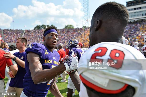 September 10 2016 East Carolina Pirates wide receiver Zay Jones and North Carolina State Wolfpack cornerback Jack Tocho meet after a game between the...