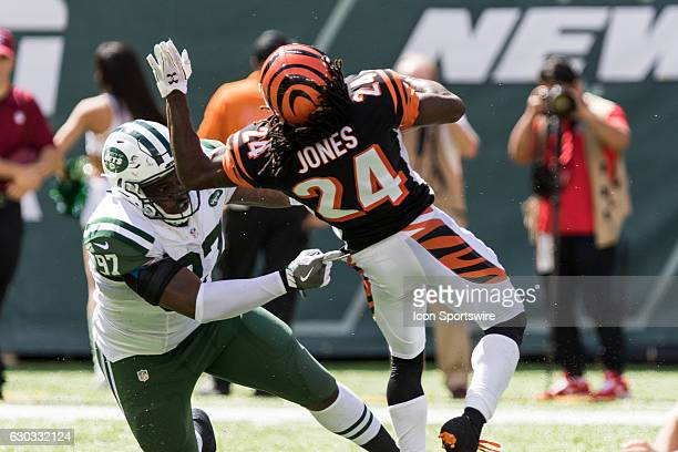 New York Jets Defensive End Lawrence Thomas [14288] hits Cincinnati Bengals Cornerback Adam Jones [7730] on a kick off return during the New York...