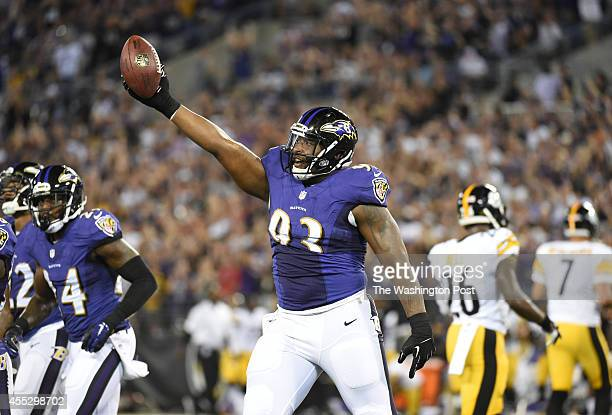 Baltimore Ravens defensive end DeAngelo Tyson recovers a fumble by Pittsburgh Steelers wide receiver Justin Brown during first quarter action on...