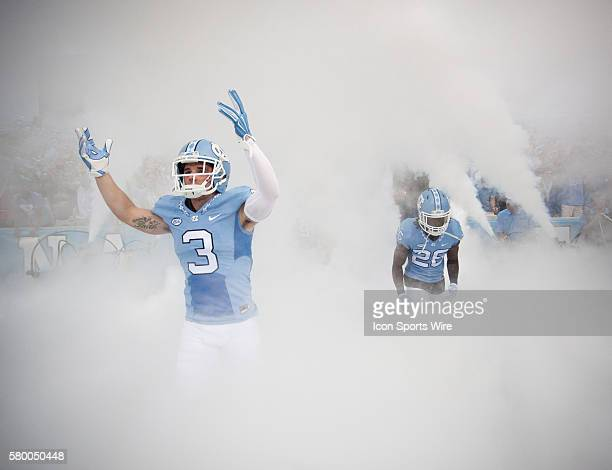 North Carolina Tar Heels Sam Smiley and Dominique Green enter Kenan Memorial Stadium prior to the start of an NCAA football game against the visiting...