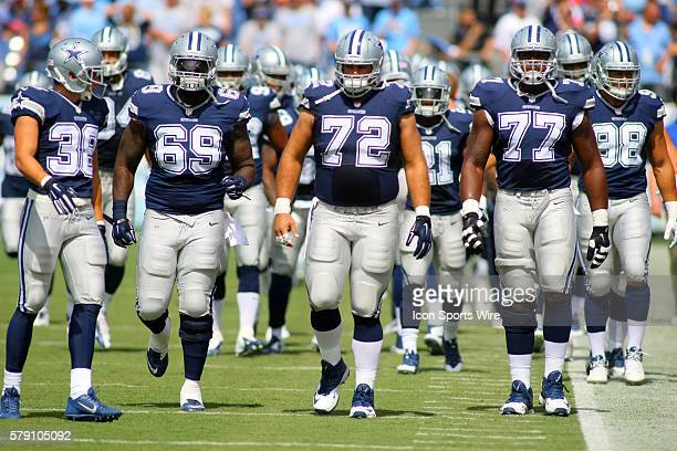 Dallas Cowboys Safety Jeff Heath [14519] Dallas Cowboys Defensive Tackle Henry Melton [11906]Dallas Cowboys Center Travis Frederick [18511] and...
