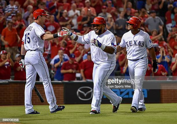 Texas Rangers designated hitter Prince Fielder scores on a double by Texas Rangers third baseman Adrian Beltre as they celebrate at home plate as...