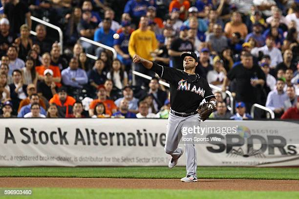 Miami Marlins Third base Martin Prado [5328] throws out New York Mets First base Michael Cuddyer [2799] during a MLB divisional game between the...