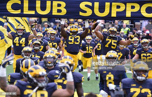 Saturday September 19 2015 Michigan players leap up and touch the M Go Blue banner before taking on UNLV Saturday at Michigan Stadium in Ann Arbor