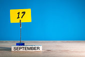 September 17th. Day 17 of month, Calendar on teacher or student, pupil table with empty space for text, copy space.