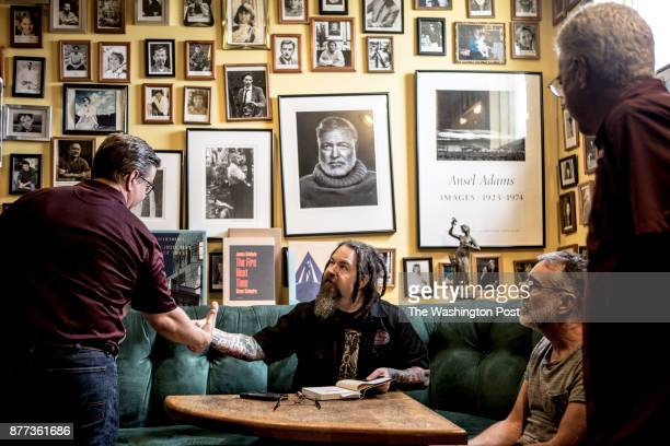 Steve Robertson hangs out with fans while at a book signing at Lemuria Books in Jackson Robertson the Mississippi State fan journalist and podcast...