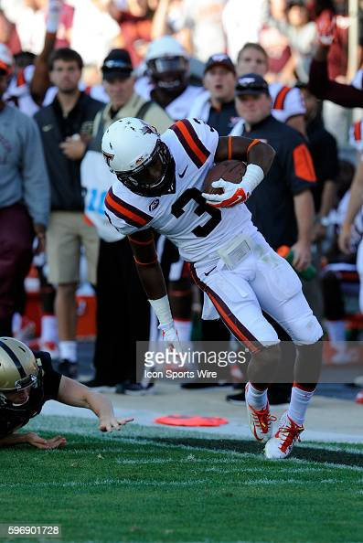 September 19 | Virginia Tech Hokie Free Safety Donovan Riley tiptoes the sideline as he returns a punt early in the game against Purdue at RossAde...