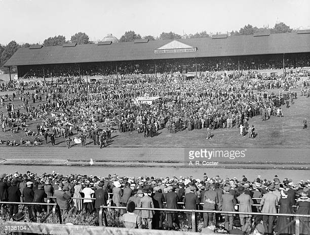 Crowds on the pitch at Stamford Bridge during a sports day in aid of disabled men