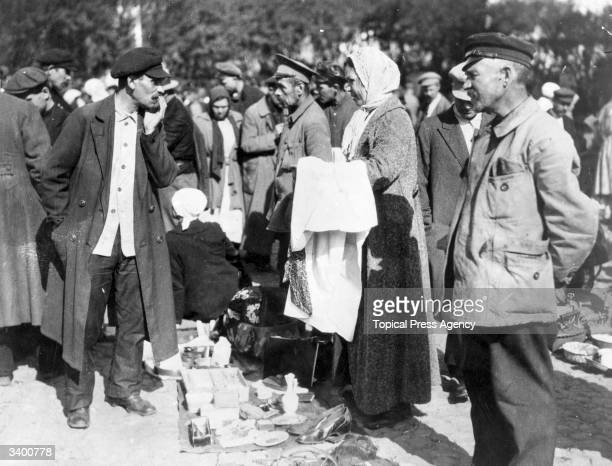 Onetime rich Russians selling their belongings at a street market in Moscow