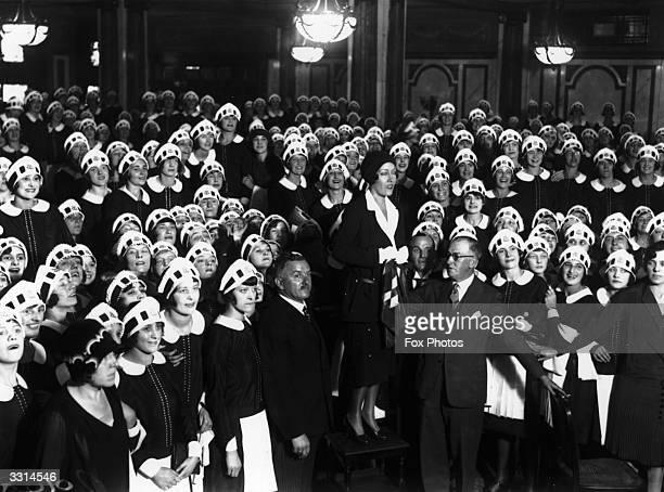 Actress Gloria Swanson amongst the 'Nippies' at Lyon's Corner House London