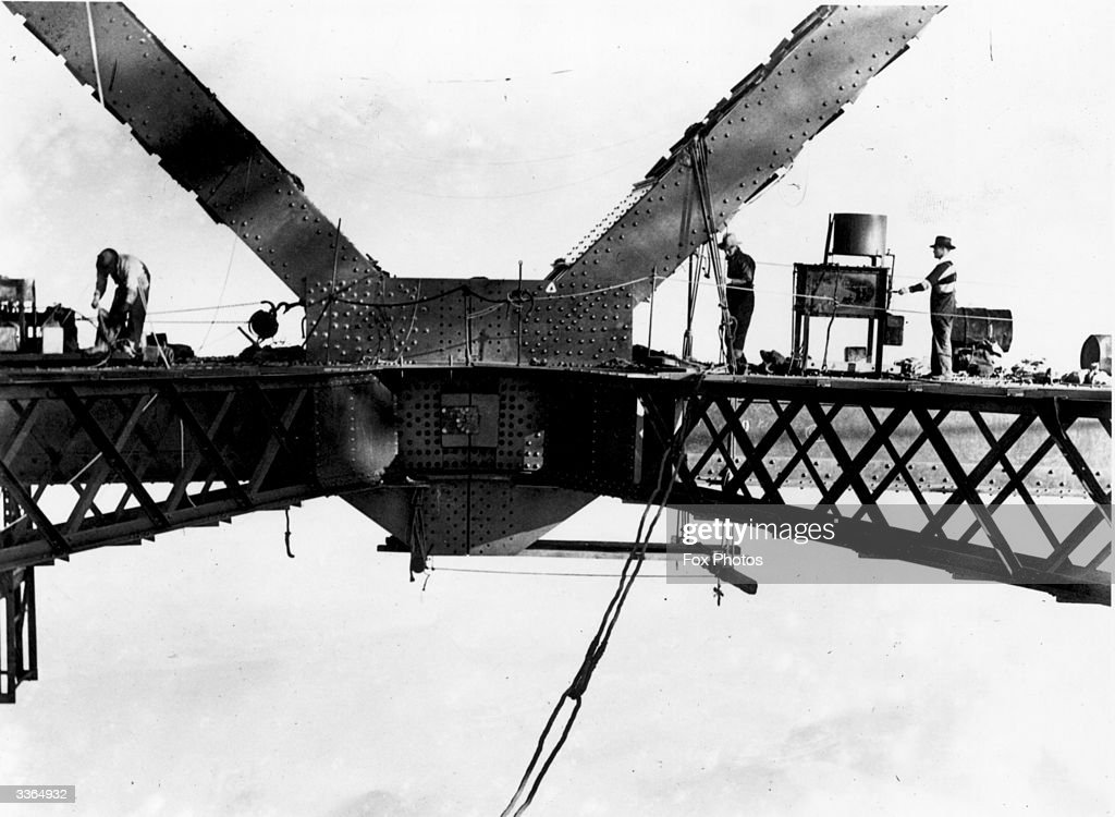 Workmen during construction of the Sydney Harbour Bridge. Upon its completion in 1932, it was the largest single-arch bridge in the world.