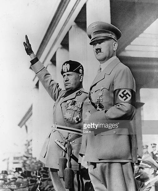German dictator Adolf Hitler and Italian dictator Benito Mussolini 'Il Duce' viewing columns of German troops in Munich during Mussolini's visit to...