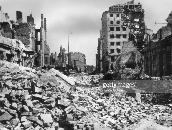 A view of rubble and ruined buildings covering the streets after the German bombing of Warsaw Poland
