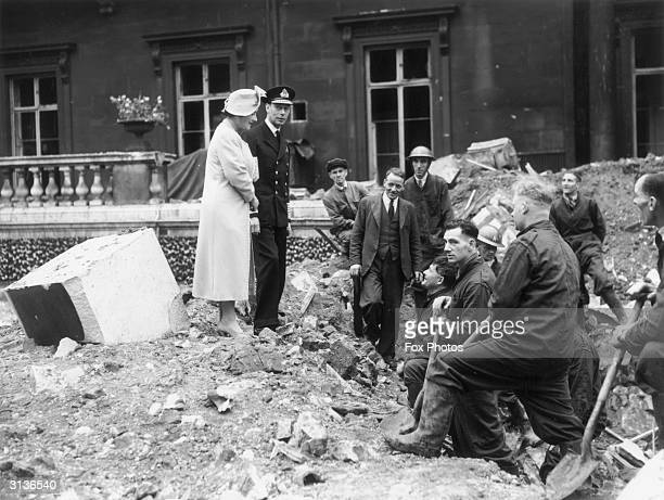 Queen Elizabeth and King George VI inspect the bomb damage at Buckingham Palace in London after an air raid attack