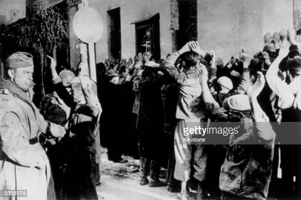 This photograph of a raid on the Jewish ghetto in Warsaw was found on the body of a German soldier killed on the Russian front During such raids Jews...