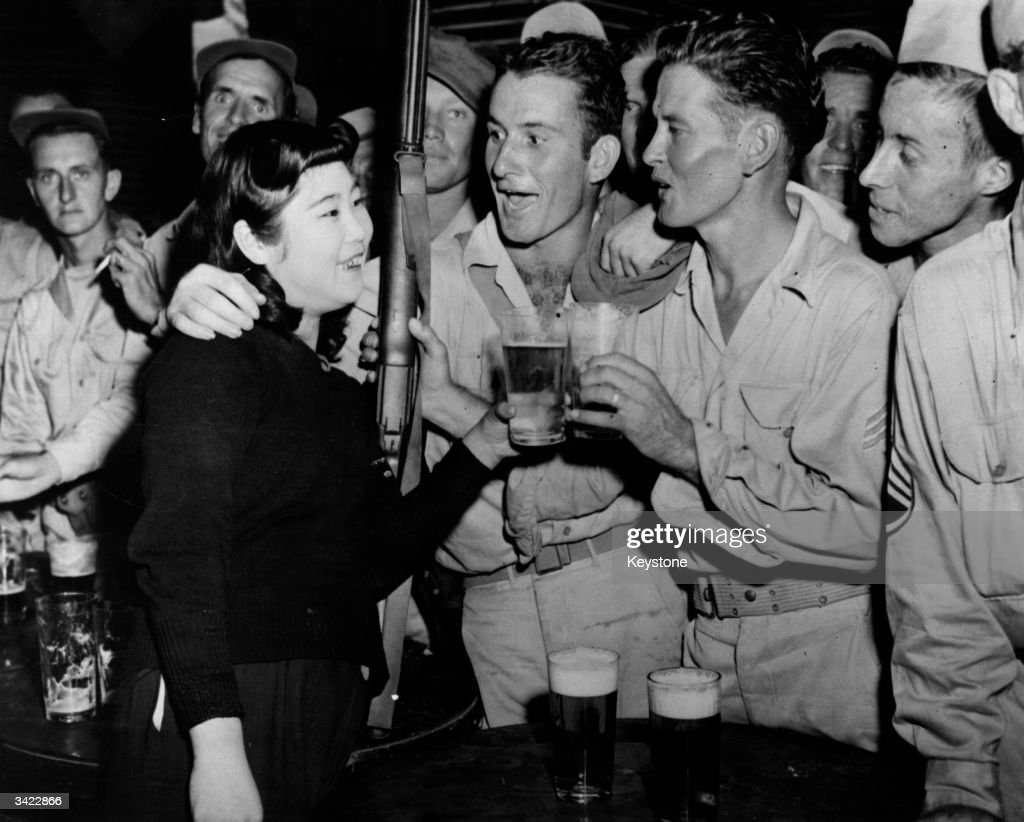 American troops sing the stein song for a japanese waitress at the raa