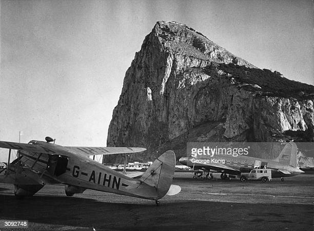 An airfield in Gibraltar with the Rock in the background