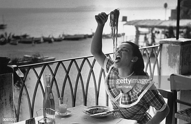 18year old London student Mercy Haystead enjoys a plate of spaghetti whilst on holiday in Italy as an official guest of the town of Positano Original...