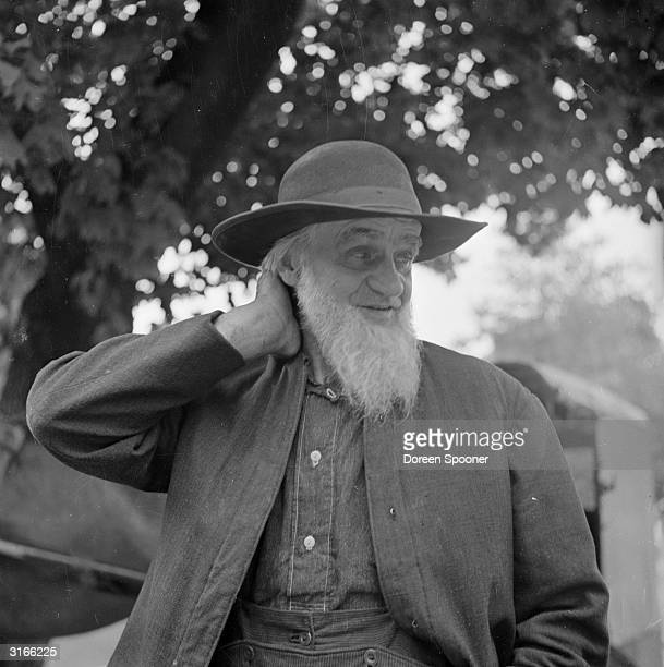 A traditionally dressed Amish man living in Lancaster County Pennsylvania His beard indicates he is a married man