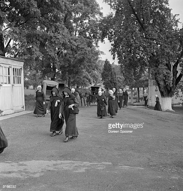 Women of the Amish community in Lancaster County Pennsylvania walking to a church service