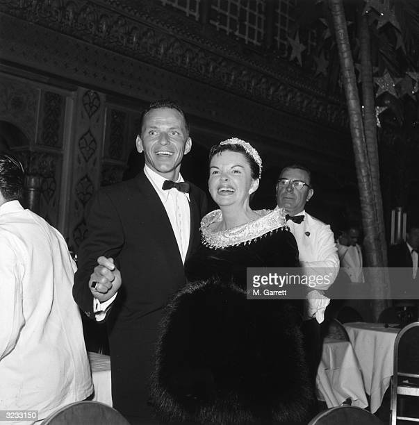 EXCLUSIVE American actors and singers Frank Sinatra and Judy Garland smile together at the premiere of director George Cukor's film 'A Star Is Born'...