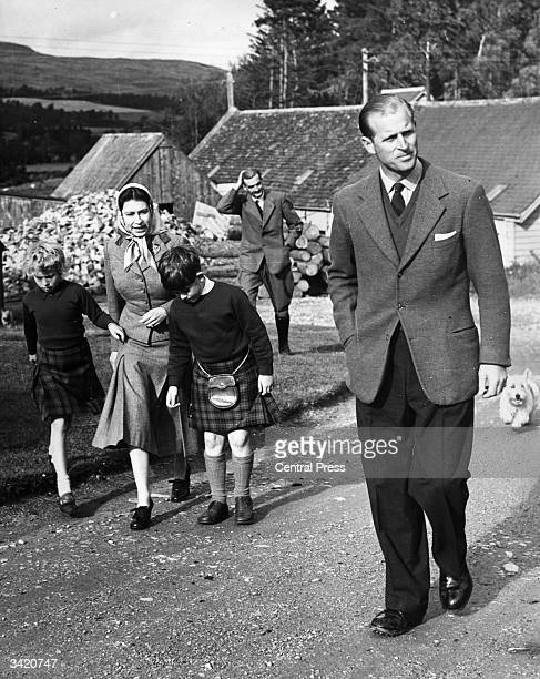 Queen Elizabeth II and Prince Philip with Prince Charles and Princess Anne during a visit to a sawmill on their estate at Balmoral Castle Scotland