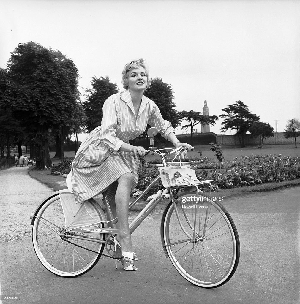 Model Peggy Hayward riding the new Raleigh bicycle specially designed for fashion-conscious women. Its attachments include a make-up mirror, lipstick holder and dress guard.