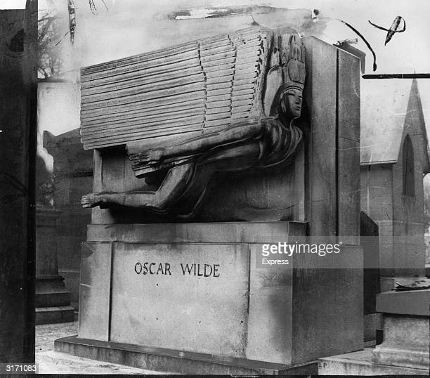 The tomb of the Irish author and playwright Oscar Wilde designed by Sir Jacob Epstein in Pere Lachaise cemetery in Paris
