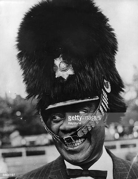 The US jazz trumpeter and singer Louis Armstrong wearing a busby belonging to one of the guards at the Tivoli amusement gardens at Copenhagen The...
