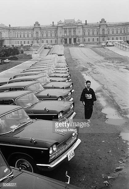 Olympic cars lined up outside the old palace in Tokyo which is the headquarters of the Olympic Committee