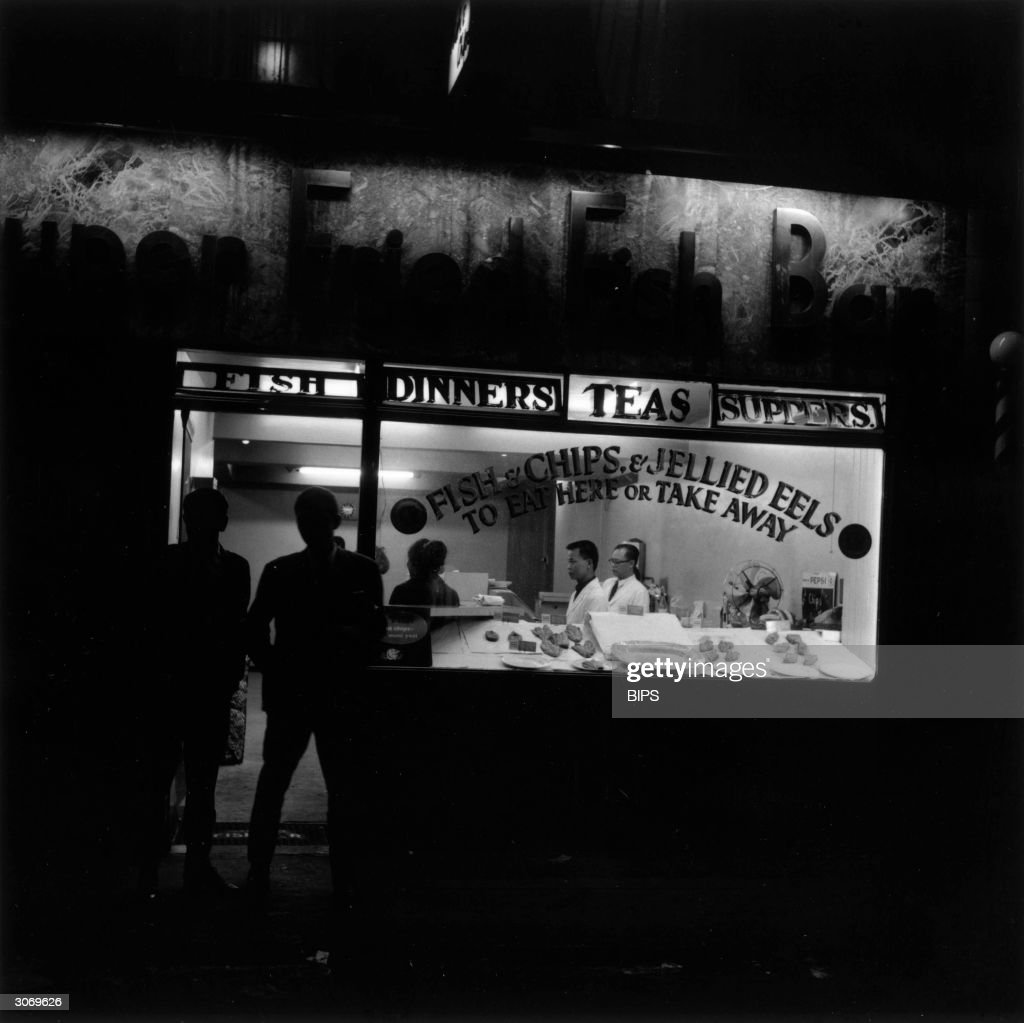A fish and chip shop in Soho, London and its night time customers.
