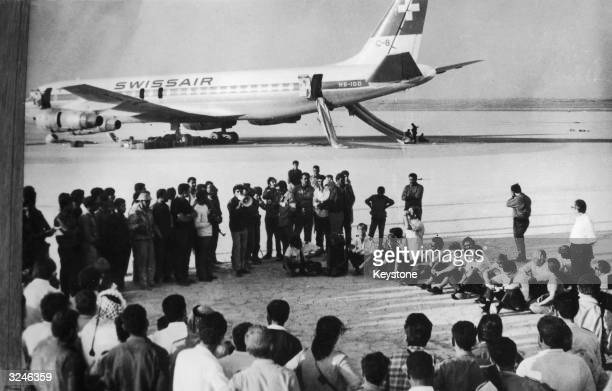 Hostages from three hijacked aircraft attend a press conference by the Popular Front for the Liberation of Palestine in the desert in front of a...