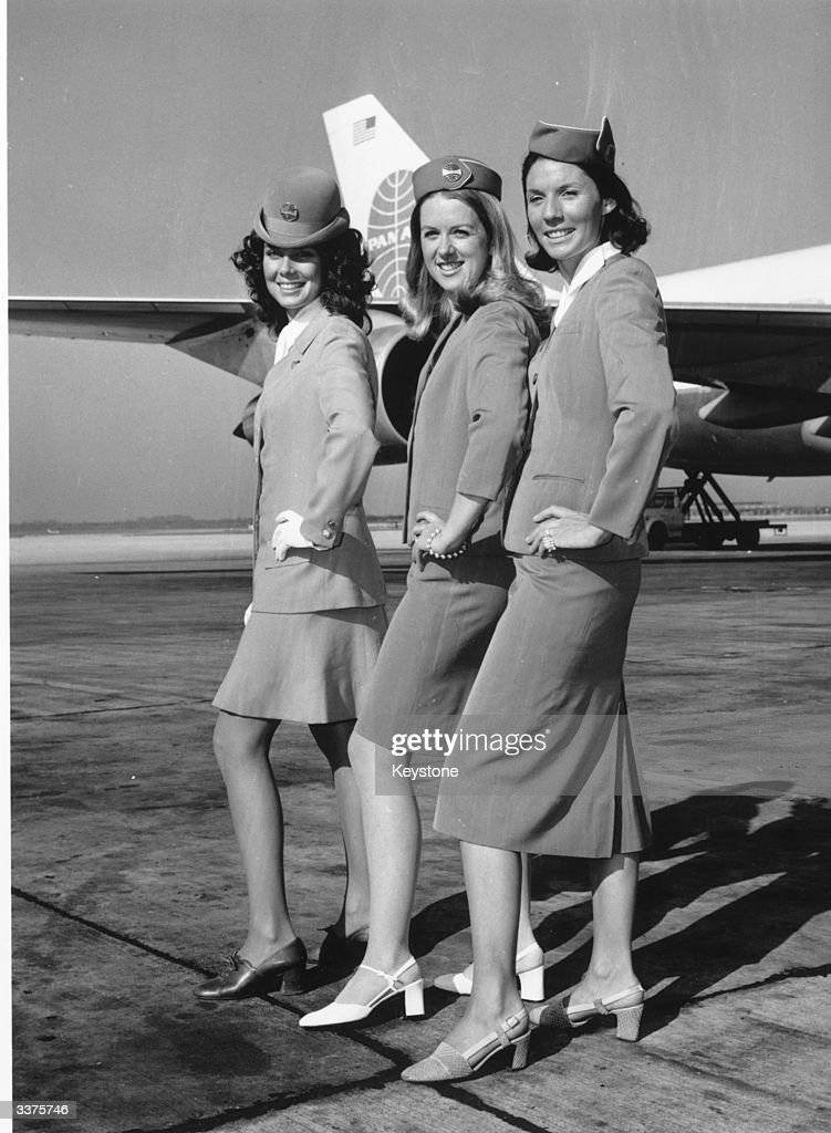 Pan American Airways stewardesses displaying the airline's uniform through the decades at London Airport. From left to right, Jan Vinson wearing the 1970 uniform, Monica Yarry in 1960 uniform and Frances Chadick in the 1950 uniform.