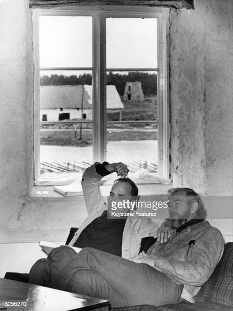 Ingmar Bergman the Swedish director with cinematographer Sven Nykvist on the Island of Faro where he was filming a television series It was filmed...