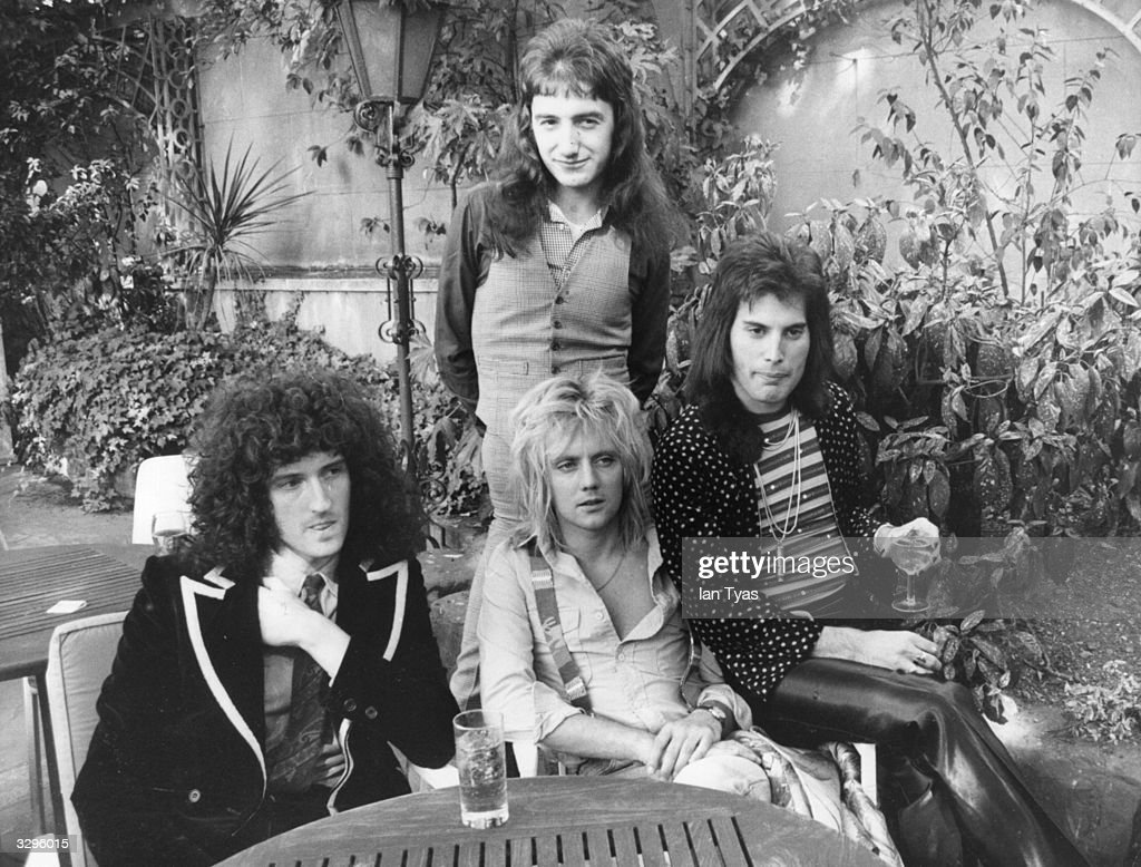 British rock group Queen at Les Ambassadeurs where they were presented with silver gold and platinum discs for sales in excess of one million of...